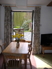 The Dining/Living Room with French Windows to Terrace